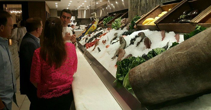 chef showing fish selection in restaurant