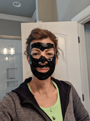 stephanie with black face mask facial