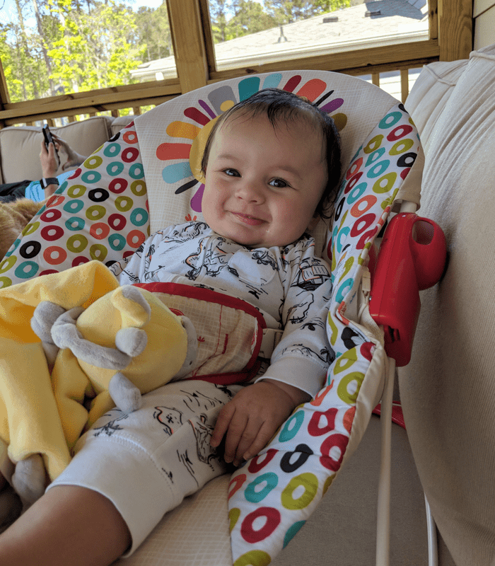 Rhett in bouncer on porch May 2018