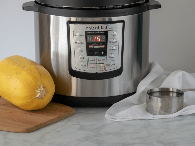 instant pot with spaghetti squash and water to cook in a hurry