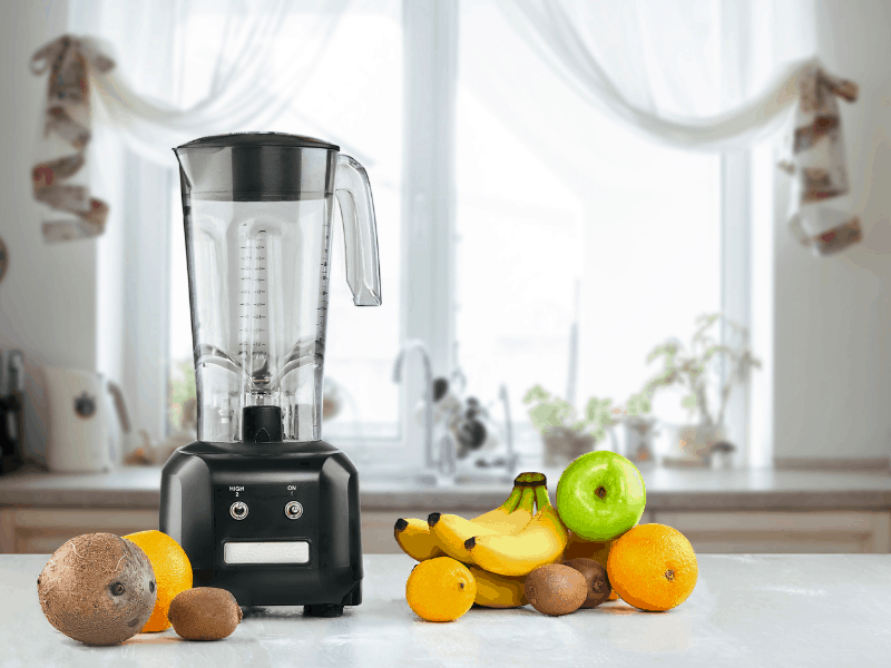 blender on counter with fruit for the best smoothie for weight loss