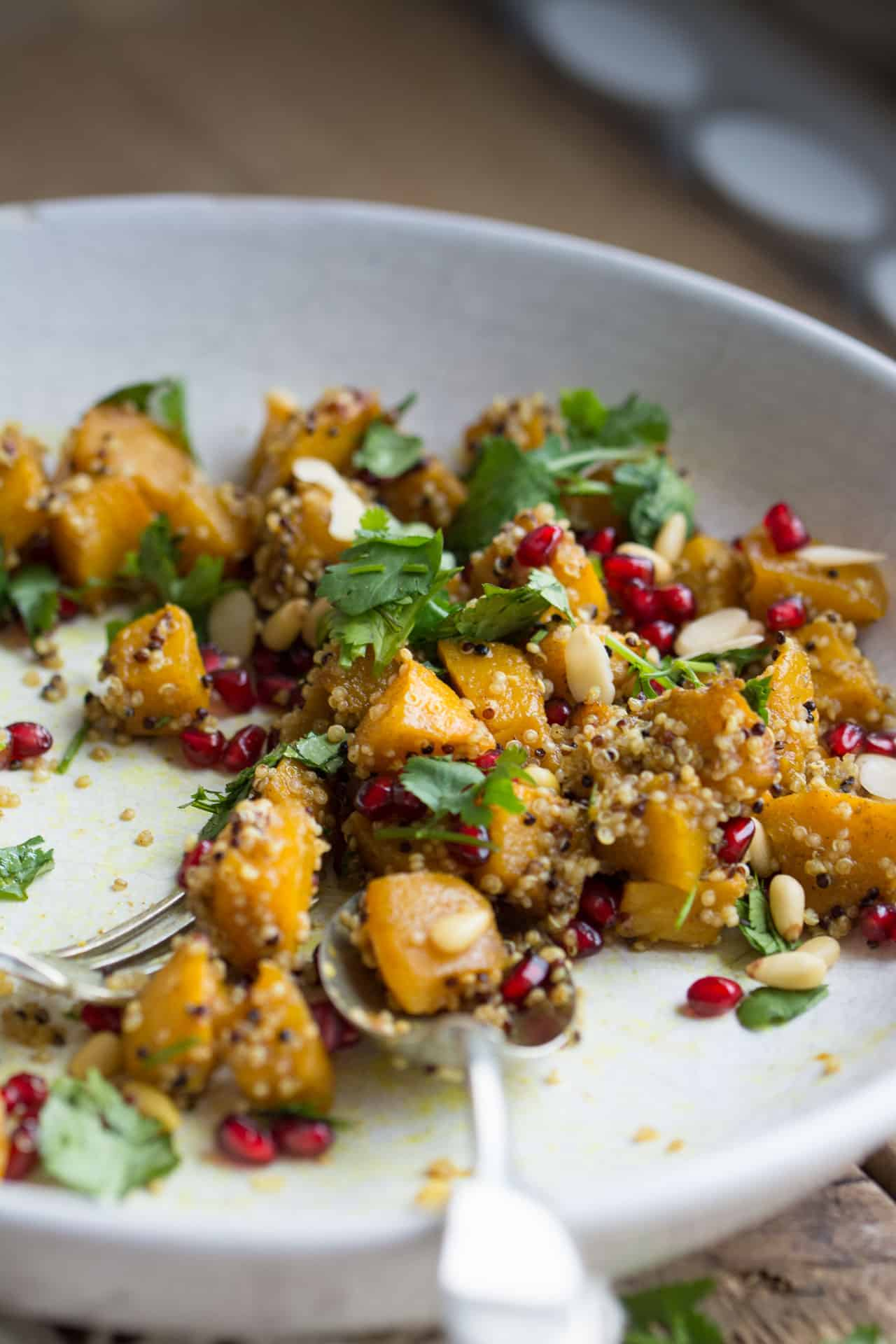 Autumn salad with pumpkin, quinoa and pomegranate in a bowl
