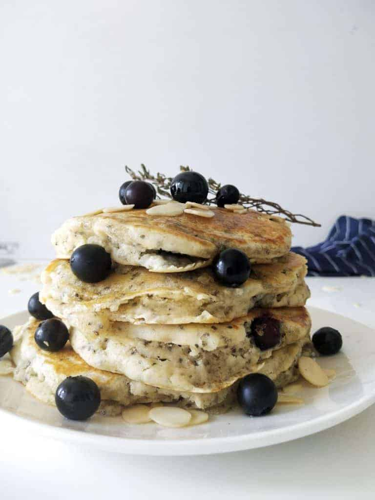plate of fluffy chia pancakes with blueberries and almonds