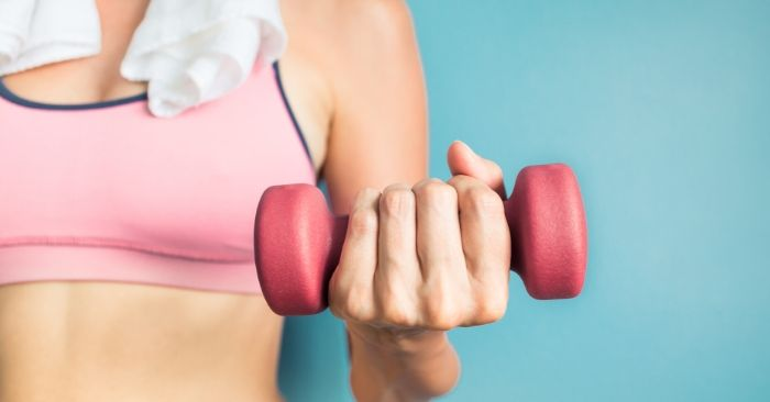 lady with dumbbell weight in hand