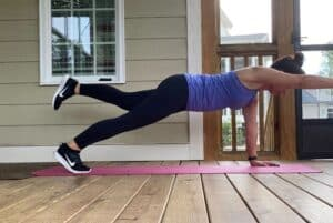 woman doing superman plank