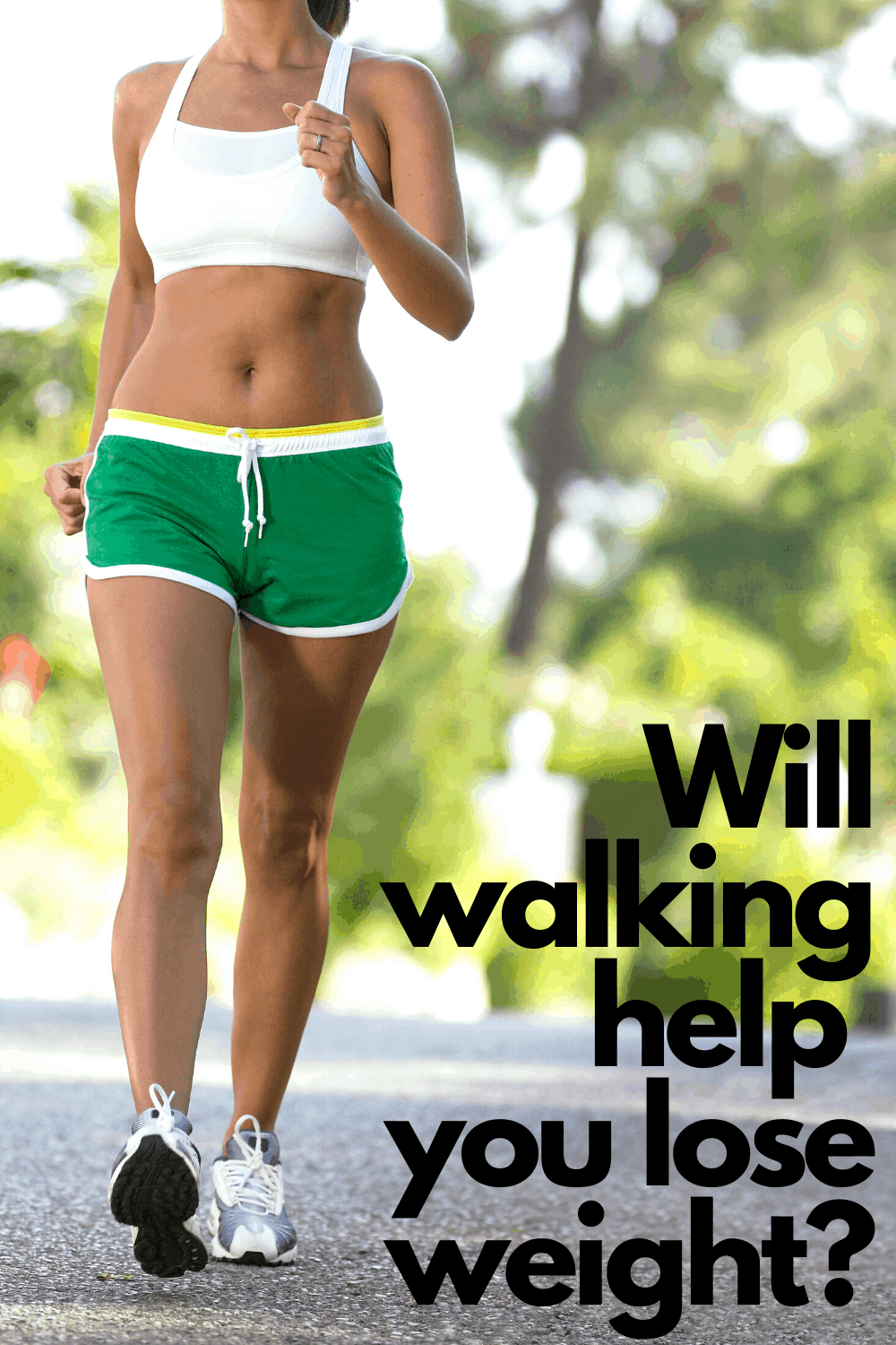 woman walking in shorts and sports bra