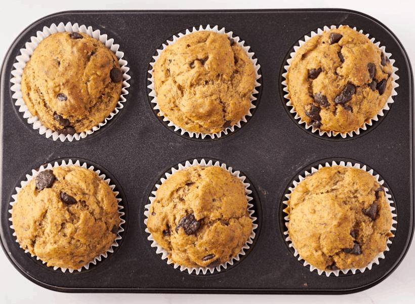 muffin tin of 6 baked banana bread muffins with no sugar