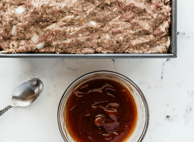 raw meatloaf in pan ready for ketchup sauce to be spread on top