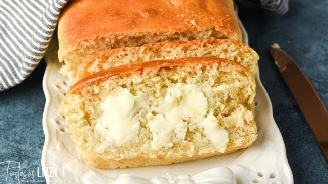 fresh baked amish sourdough bread sliced with butter melting