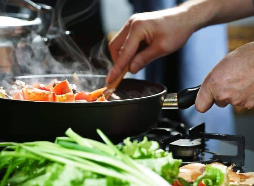 person cooking in a pan